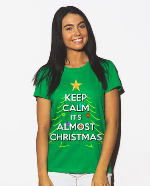 Keep Calm It's Almost Christmas Graphic T-Shirt - green shirt design on a model