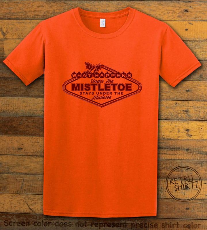 What Happens Under The Mistletoe Stays Under The Mistletoe Graphic T-Shirt - orange shirt design