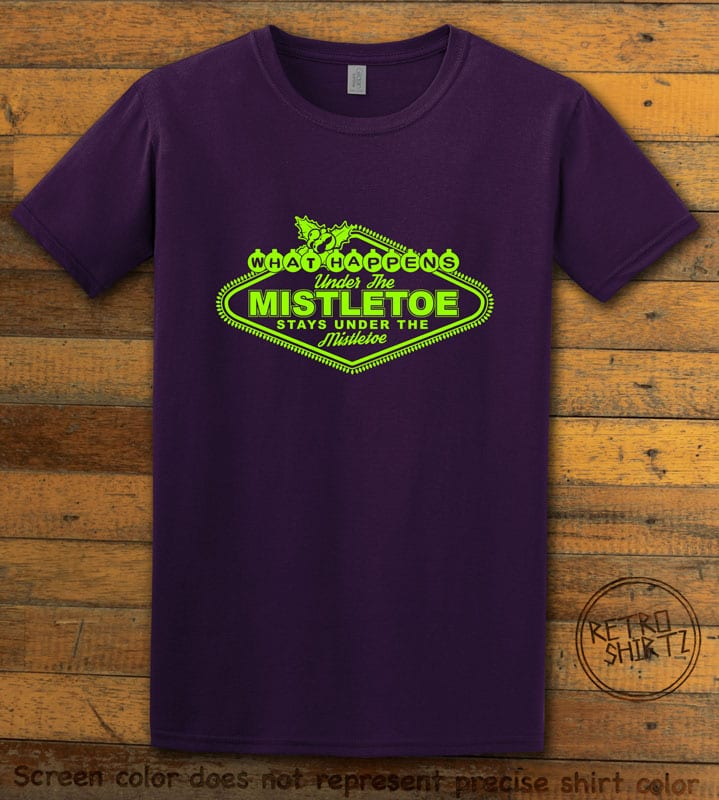 What Happens Under The Mistletoe Stays Under The Mistletoe Graphic T-Shirt - purple shirt design