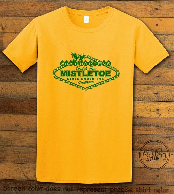 What Happens Under The Mistletoe Stays Under The Mistletoe Graphic T-Shirt - yellow shirt design