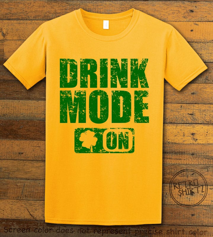 This is the main graphic design on a yellow shirt for the St Patricks Day Shirts: Drink Mode On