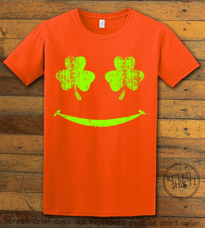 This is the main graphic design on a orange shirt for the St Patricks Day Shirts: Shamrock Smiley Face
