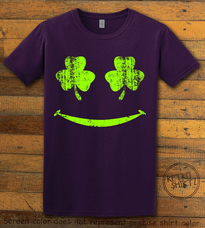 This is the main graphic design on a purple shirt for the St Patricks Day Shirts: Shamrock Smiley Face