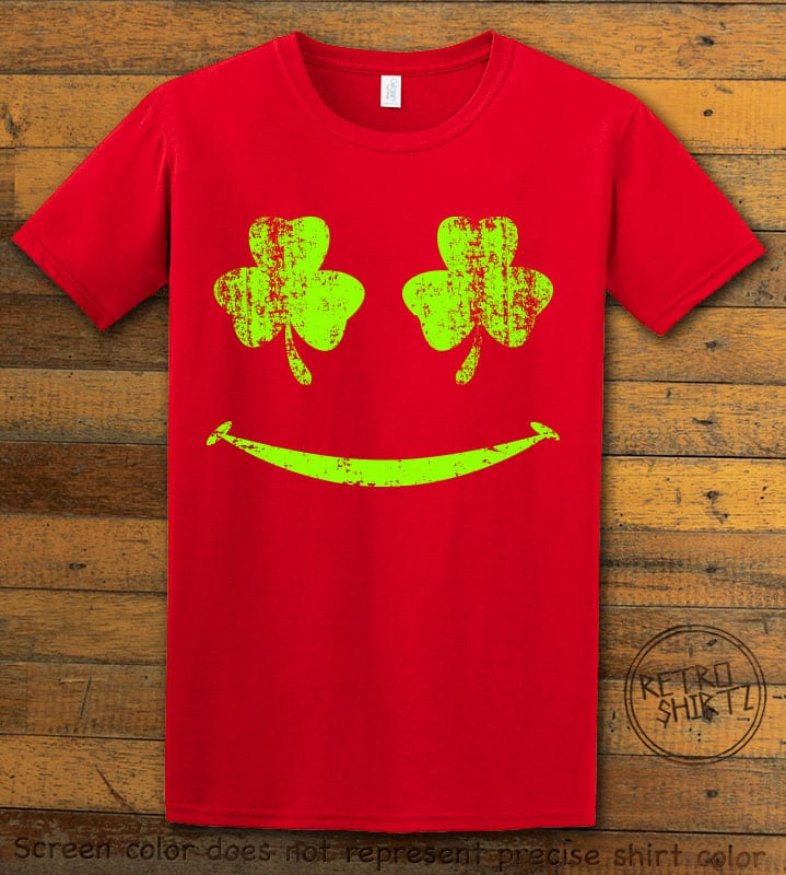 This is the main graphic design on a red shirt for the St Patricks Day Shirts: Shamrock Smiley Face