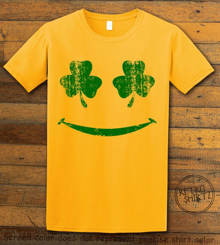 This is the main graphic design on a yellow shirt for the St Patricks Day Shirts: Shamrock Smiley Face