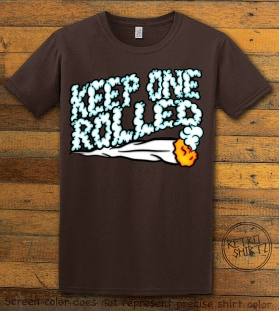 This is the main graphic design on a brown shirt for the Weed Shirt: Keep One Rolled