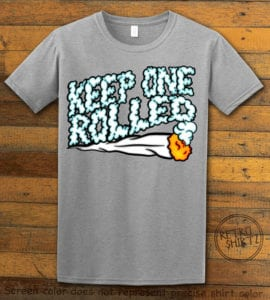 This is the main graphic design on a gray shirt for the Weed Shirt: Keep One Rolled