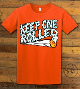 This is the main graphic design on a orange shirt for the Weed Shirt: Keep One Rolled