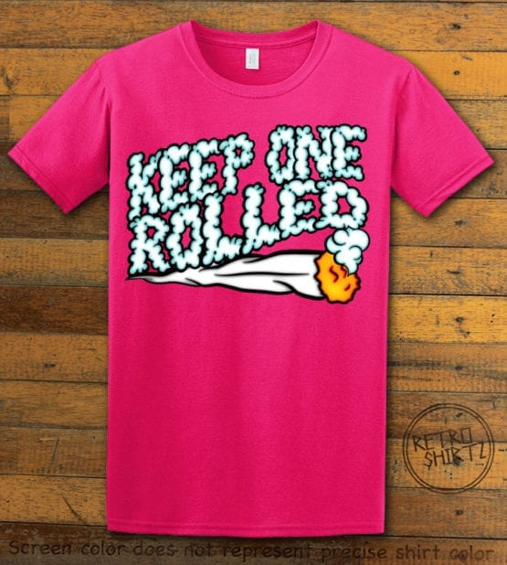 This is the main graphic design on a pink shirt for the Weed Shirt: Keep One Rolled