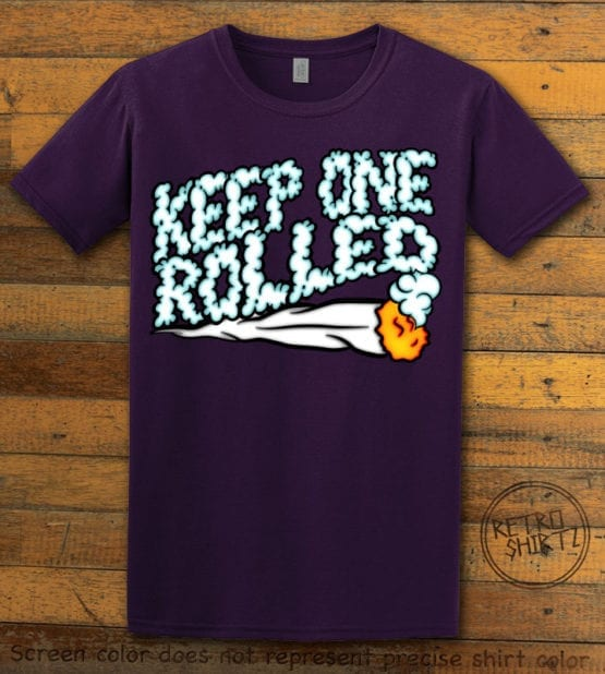 This is the main graphic design on a purple shirt for the Weed Shirt: Keep One Rolled
