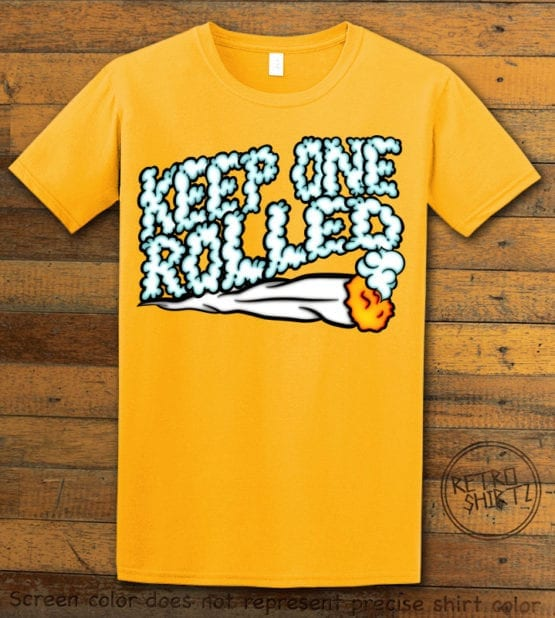 This is the main graphic design on a yellow shirt for the Weed Shirt: Keep One Rolled
