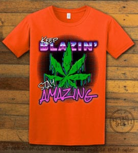 This is the main graphic design on a orange shirt for the Weed Shirt: Keep Blazin' Stay Amazing